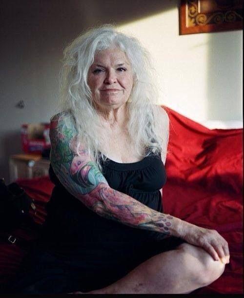 Tattooed older woman. Tattooed lifestyle.