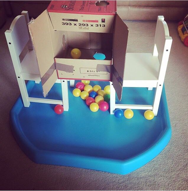Ball drop game -cardboard box and colourful balls