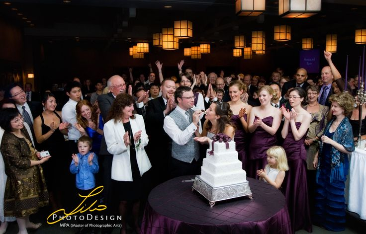 Bride and groom cutting the cake all by themselves in a corner would not tell a story. I gather wedding party around the bride and groom to celebrate the special moment. See more samples at; lilophotodesign.ca