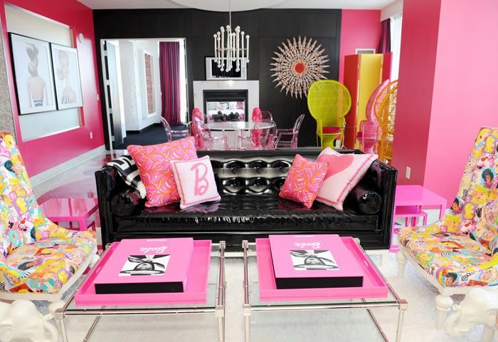 Staying in the Hot Pink Suite at the Palms Hotel and Casino in Las Vegas is like stepping into your own private Barbie Dream House. The Jonathan Adler-designed space is full of bright Barbie-approved colors, and even has a sunburst mirror made out of 65 of the iconic dolls.   - ELLEDecor.com