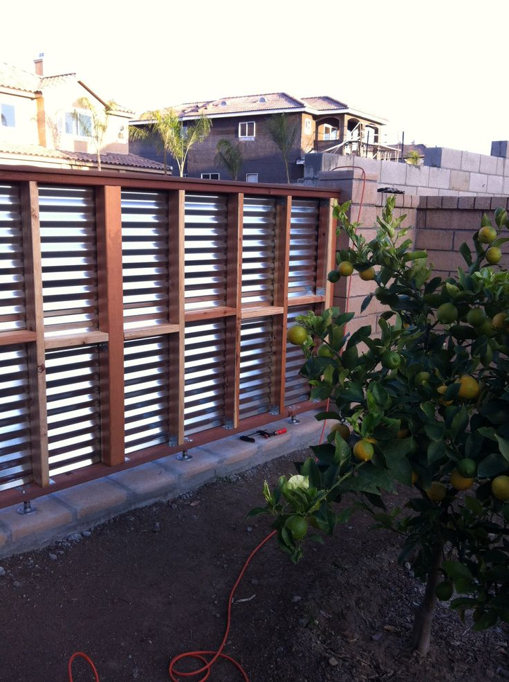 DIY fence section made of wood frame and corrugated tin ...