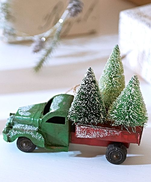 Little green and red truck taking the trees home for Christmas our Vintage Collection from the States takes you right back to a classic fifties