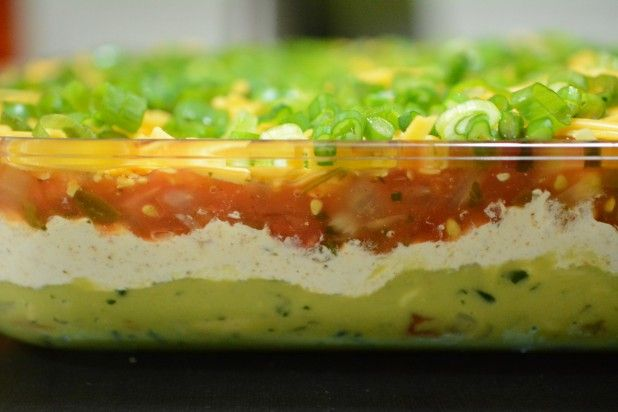 5-layer Keto Dip: Guacamole, sour cream, salsa, cheese. Dip carrots, broccoli, cauliflower, lettuce leaves