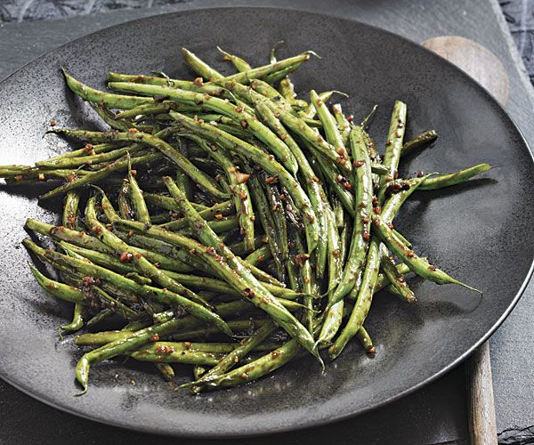 Though these delicate green beans are traditionally saved for fancy French preparations, they're also perfect for a quick stir-fry. Jarred black bean sauce serves as a light base for the sauce while minced ginger and garlic impart a heady punch.