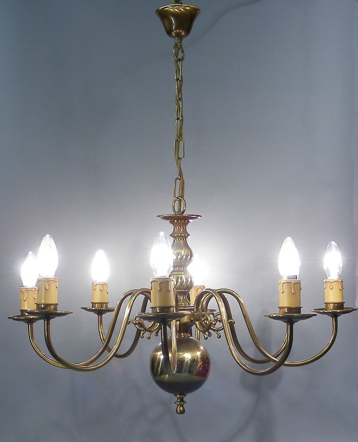 A gorgeous vintage bronze flemish style 8 branch chandelier the bronze has a beautiful soft aged