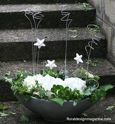 White  #floral  #arrangement with Holly and Hydrangeas www.floraldesignmagazine.com/Christmas annuals.html #Christmas #holidayflowers #Xmas