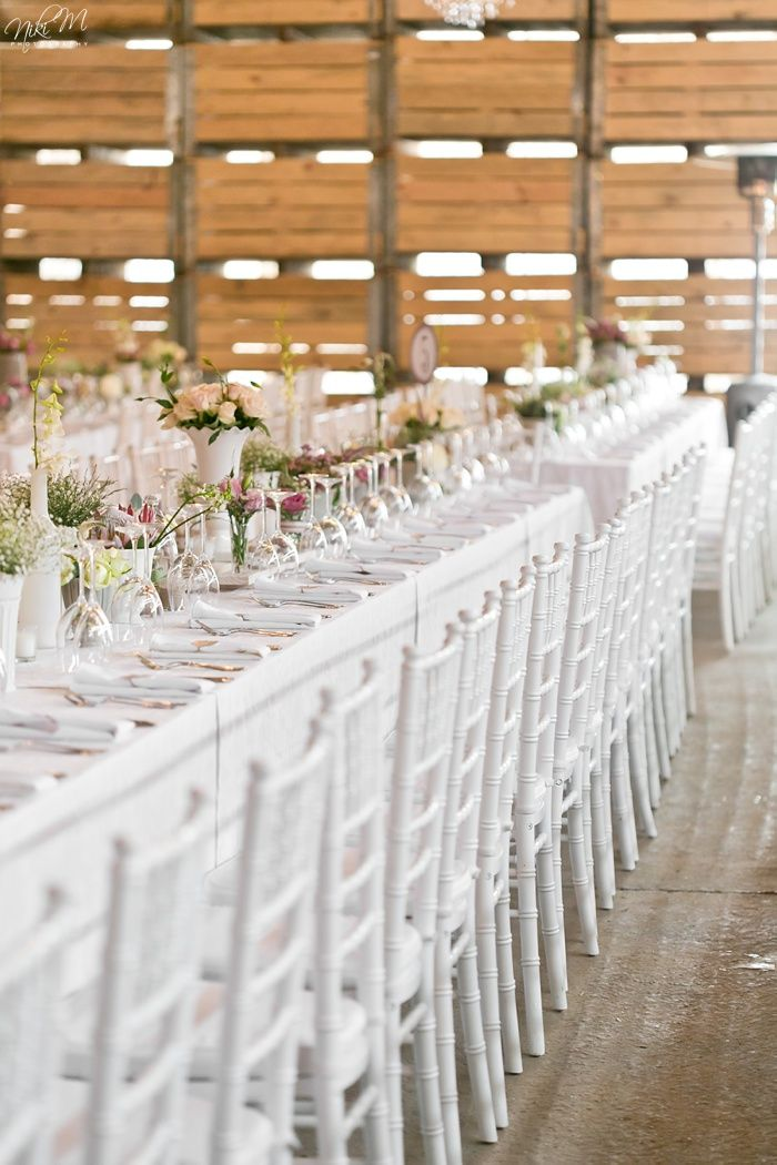 Barn Wedding on a farm with long tables and white Tiffany chairs Niki M Photography
