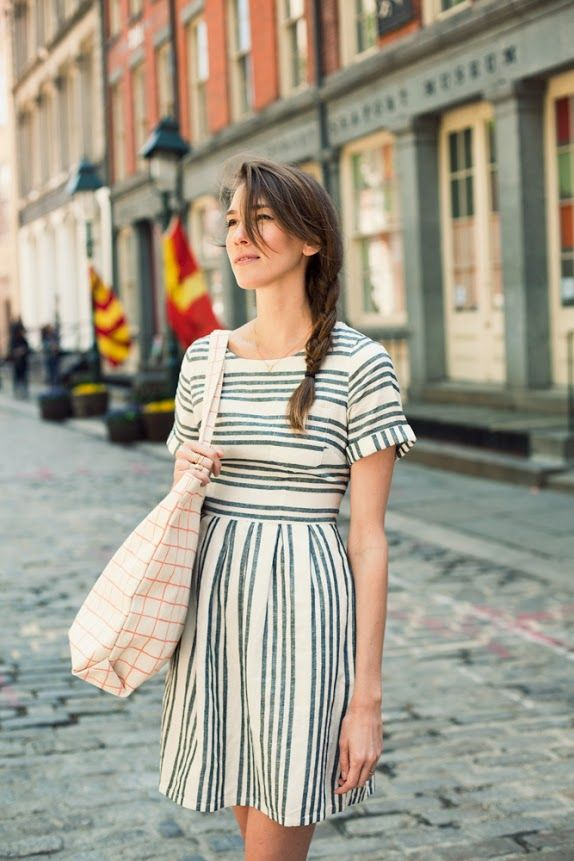 super cute. striped dress, casual braid and patterned bag.