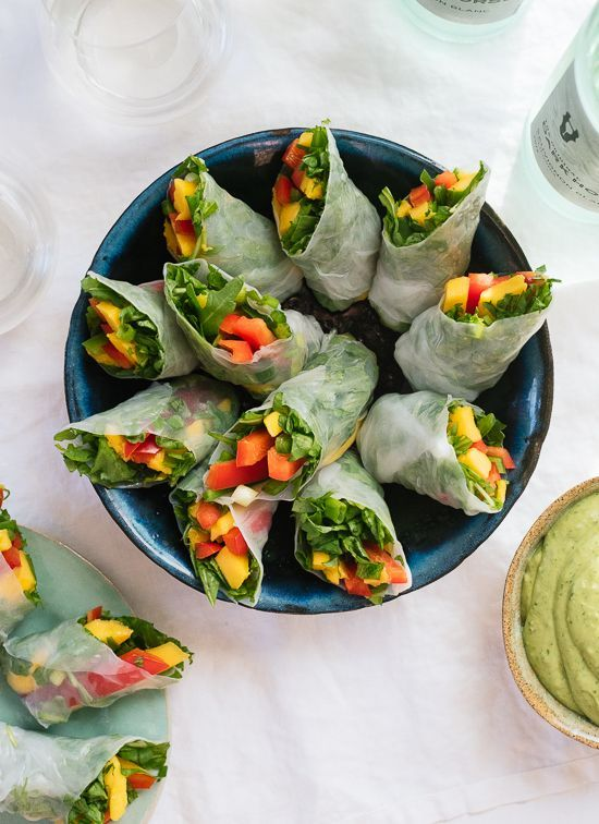 Tropical mango spring rolls with avocado cilantro sauce.