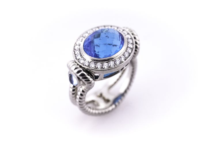 London Blue checkerboard topaz ring in white gold accented by diamonds.