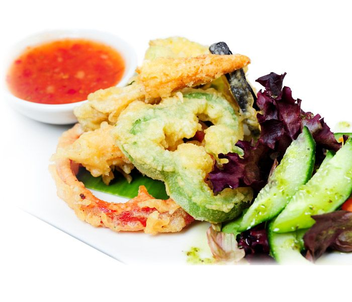 Green Vegetable Tempura with Sticky Dipping Sauce. A traditional Japenese dish which involves deep frying vegetables or shrimp in batter.