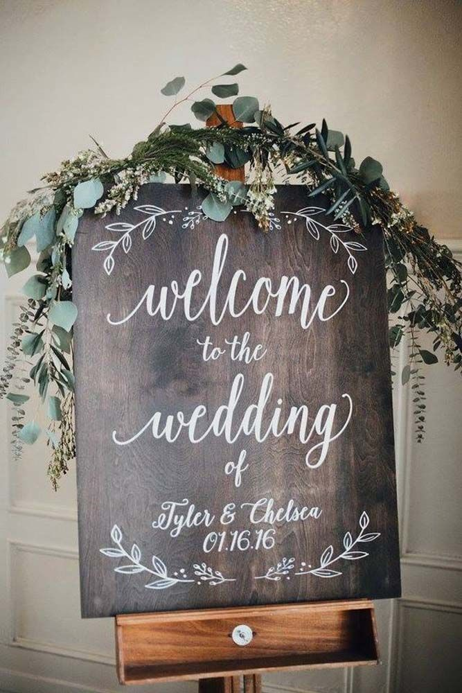 welcome rustic wood wedding signs with greenary