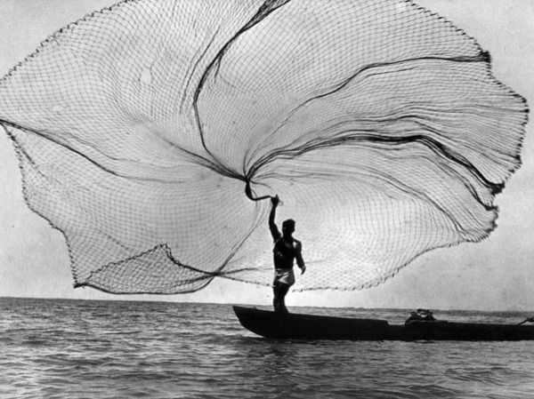 This photo is by Bresson. He is known for his decisive moments. He captures great photos that take great patience and quick thinking. This photo casting a fish net out in the ocean is beautiful. Capturing the open waters and the single fisherman  throwing his net out at the perfect moment! It makes you wonder how long or how many times he waited for this perfect shot.