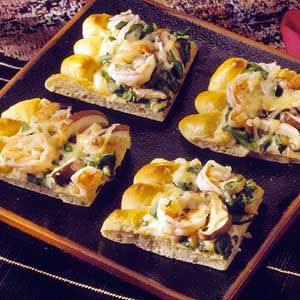 ... shiitake mushrooms, and pine nuts top this elegant appetizer pizza