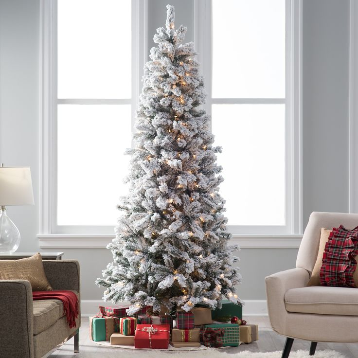 7.5 ft. Classic Flocked Slim Pre-Lit Christmas Tree - There's nothing that says Christmas quite like fresh snow on the trees, and no matter when you put up the 7.5 ft. Classic Flocked Slim Pre-Lit...