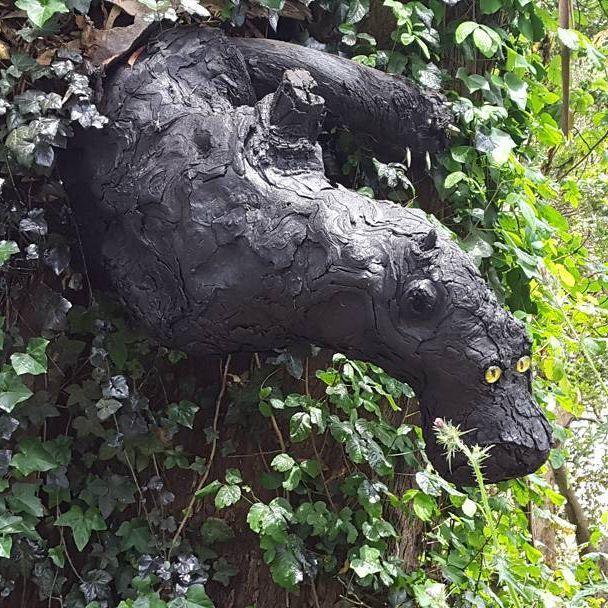 """Known affectionally to the locals as """"Bagheera"""", this odd growth adorns the side of a tree covered in ivy vines. With the addition of eyes, this hauntingly beautiful attraction looks like a black panther hugging the side of this tree right out of The Jungle Book!  ▪▪▪  #attraction #growth #bagheera #thejunglebook #kids #stories #panther #jungle #cat #weird #neat #oddities"""