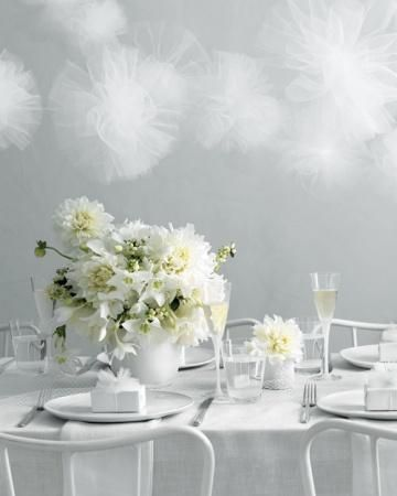 Tulle pom-poms in white are festive and classy