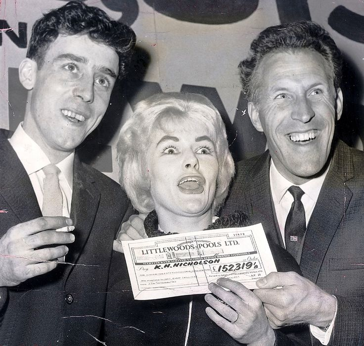 Littlewoods Pools winners Keith & Viv Nicholson presented with their cheque for £152,319 by Bruce Forsyth in September 1961.