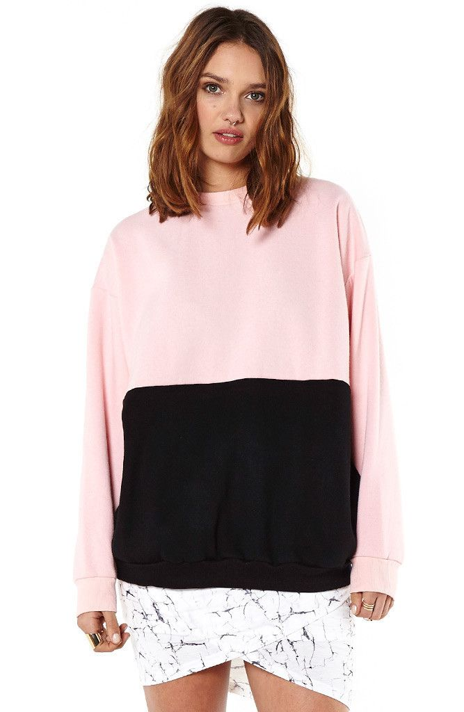 Fun spliced sweatshirt from MARKET HQ. Pink and black is an awesome combo and paired with your running tights or shorts, this is coolest of the cool ways to cool down post workout.