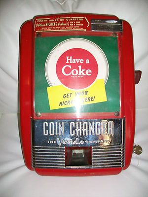 vintage coca cola coin changer. laundramats had these to get change for the machines.