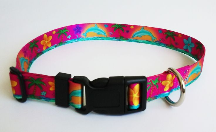 Dolphins, Frangipani and Palm Trees, set on a Pink background has that total Island feel that your Dog can wear. Makes you feel like you are a Parrothead in a Jimmy Buffett Margaritaville song!  Another great Island Dog Collar Design by Wagadoodle in Key West!