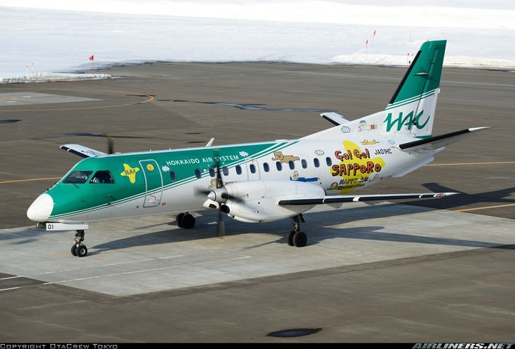 Hokkaido Air System-HAC (JP) Saab 340 JA01HC aircraft, with ''GO-GO! Sapporo Happy Air Connection'' sticker on the airframe, parked at Japan Sapporo Okadama Airport. 15/01/2015.