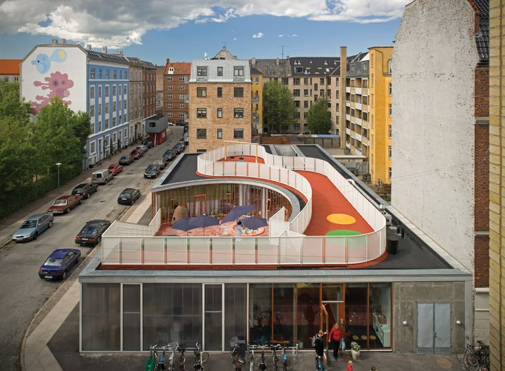 Built by Dorte Mandrup in Copenhagen, Denmark with date 2005. Images by Jens Markus Lindhe. The neighborhood of Skanderborggade/Krausesvej is characterized by a mix of buildings made up of dense urban blocks f...