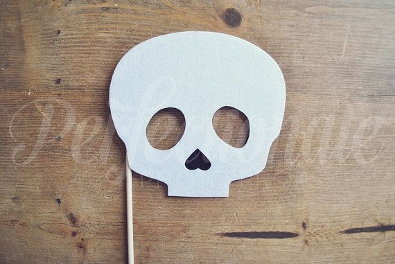 This Skull prop is perfect for your Halloween photo booth or Halloween party! Skull prop is hand-made from several layers of stiff white felt and