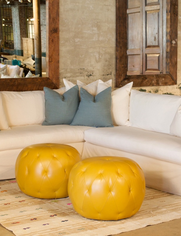 Fancy These adorable bright yellow poufs will add a pop of color
