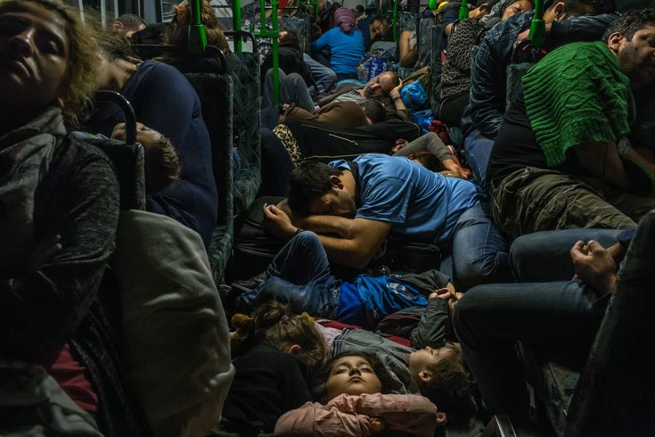 The Year in Pictures 2015 - The New York Times - BUDAPEST, HUNGARY 9/5/2015 A Syrian father, center, slept with his son and other family members on the floor of a bus driving from Budapest to Vienna.