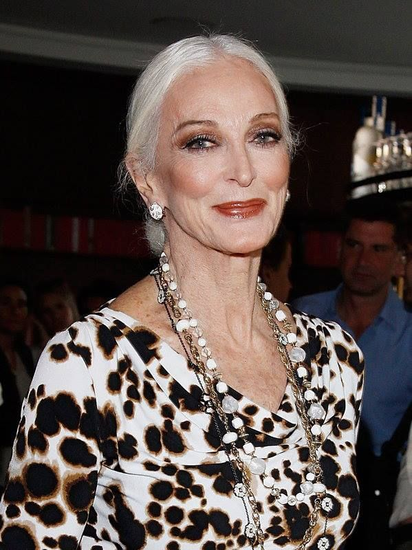Carmen Dell'Orefice.   Animal print always works...especially high contrast.  Chocolate & white, black & white...   statement jewelry
