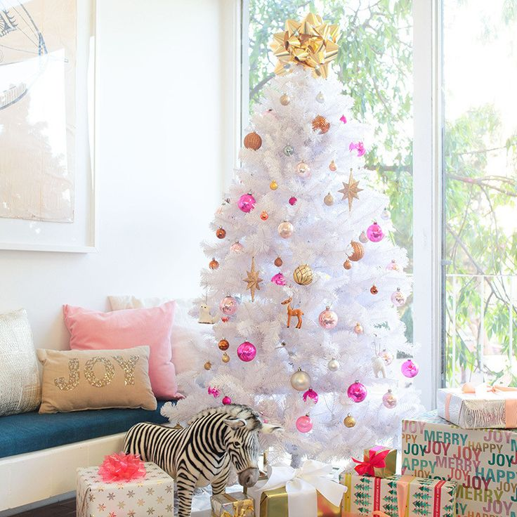 """Rethink the traditional Christmas tree. I love this white one because it complements the rest of my space without being too distracting. Also consider an oversized bow in place of a traditional tree topper. So cute!"""