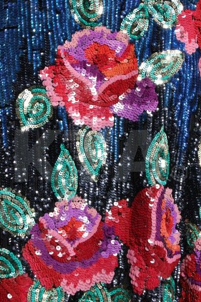Detail of the roses embroidered in sequins.