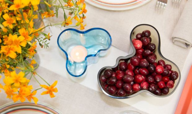Repurpose your vase with a votive or filling it with organic materials like cranberries, nuts or pine needles. This centerpiece for a modern Thanksgiving Table Setting done by fitzsu.com uses the Aalto vase for both candle light and centerpiece.