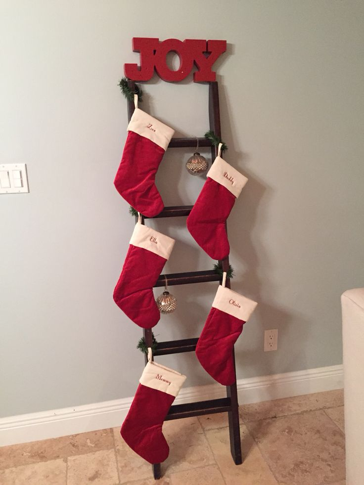 DIY repurpose. Christmas ladder stocking holder.  Found an old bunk bed ladder on Craigslist for $10 and turned it into a rustic style stocking holder.