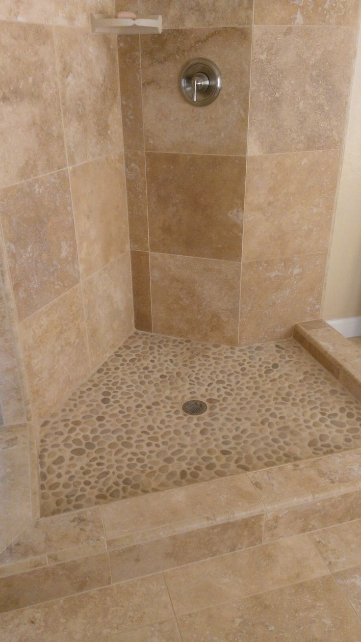 Pebble flooring for wet room - mixed with large tiles