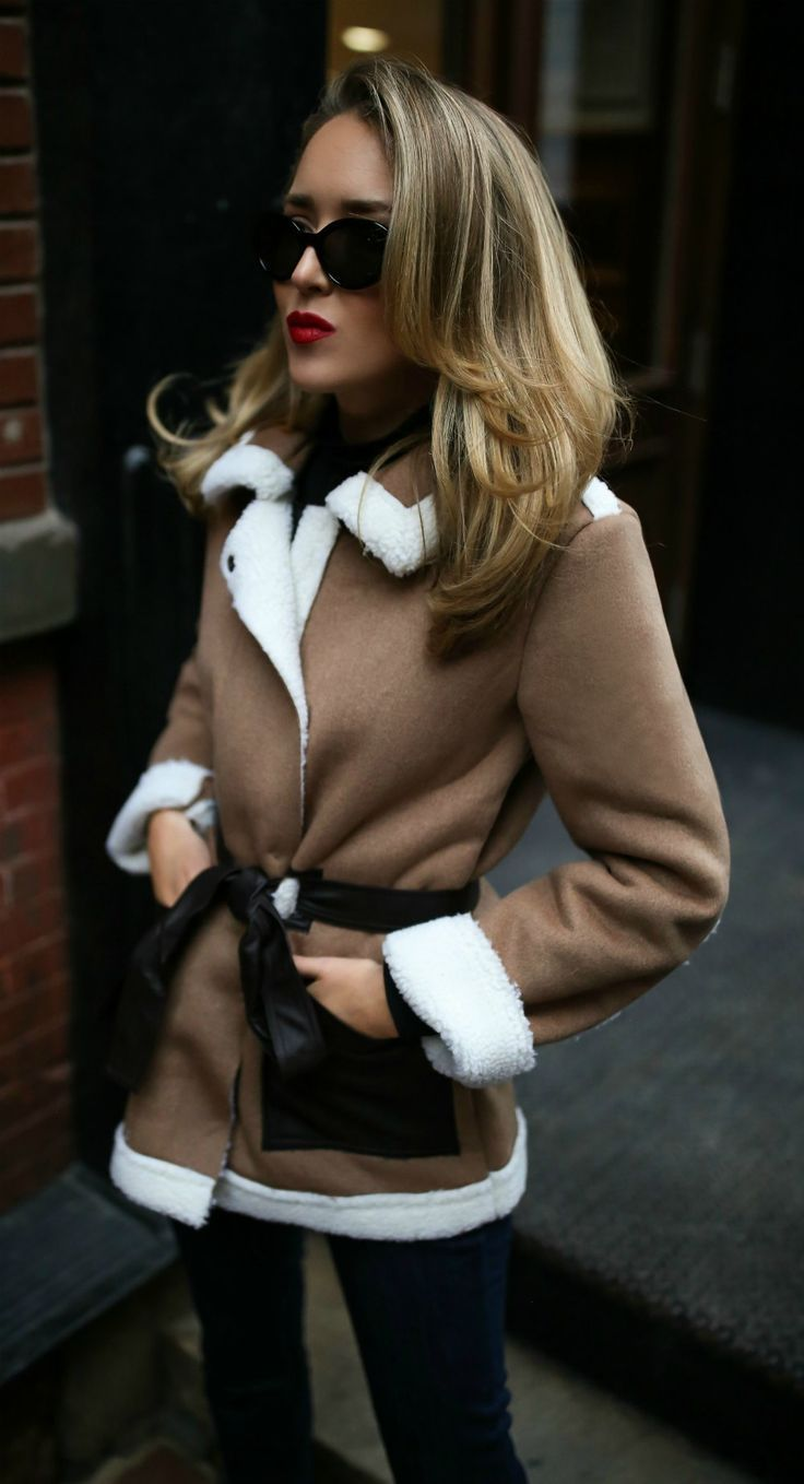 WINTER MEMO #2: Shearling Jackets and Coats // Tan shearling coat with waist belt, dark wash denim jeans, black turtleneck, black oval sunglasses {winter essentials, chic outerwear trends, classic leather jacket, warm workwear style, chic winter trends}