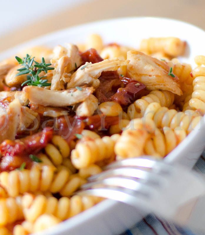 zoom of pasta and tomato with chicken