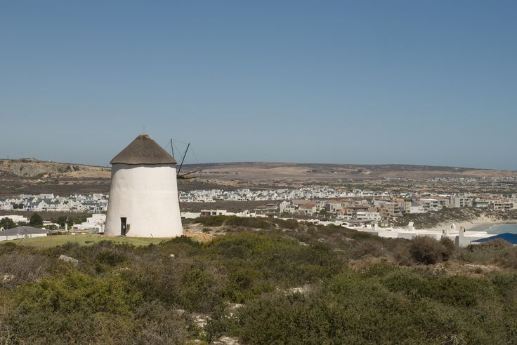 """The windmill on top of the hill above Club Mykonos in Langebaan is one of the most well-known """"beacons"""" on the West Coast - overlooking the Langebaan lagoon. For more information about properties available in this West Coast town, you can visit the CCH shop in the Laguna Mall in Langebaan or follow the link to our website: http://www.cch.co.za/res…/residential/for-sale/langebaan/…/… #langebaan #windmill #langebaanlagoon #lagoon #westcoast"""