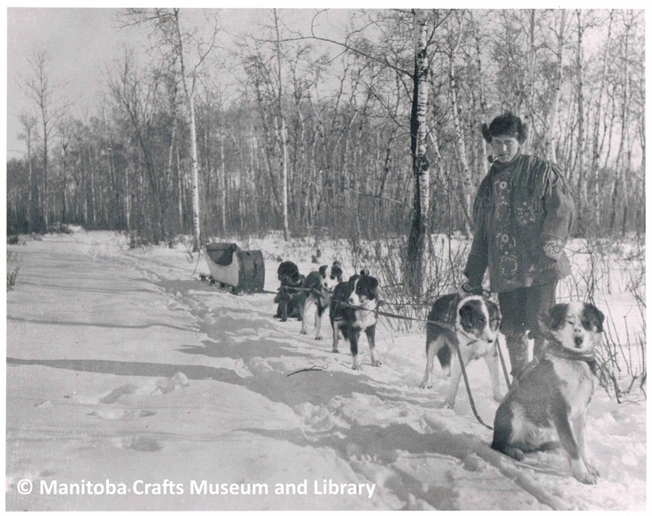 Photograph of Eric Berman with dog sled team. Jacket he is wearing is in MCML collection.    Information on back of photograph:  H. Eric Bergman / 1893 - 1958 / Fisher Branch, Manitoba / c. 1917
