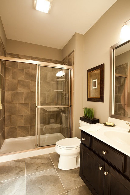 Clean and modern bathroom inside the new custom model home for New home bathroom ideas
