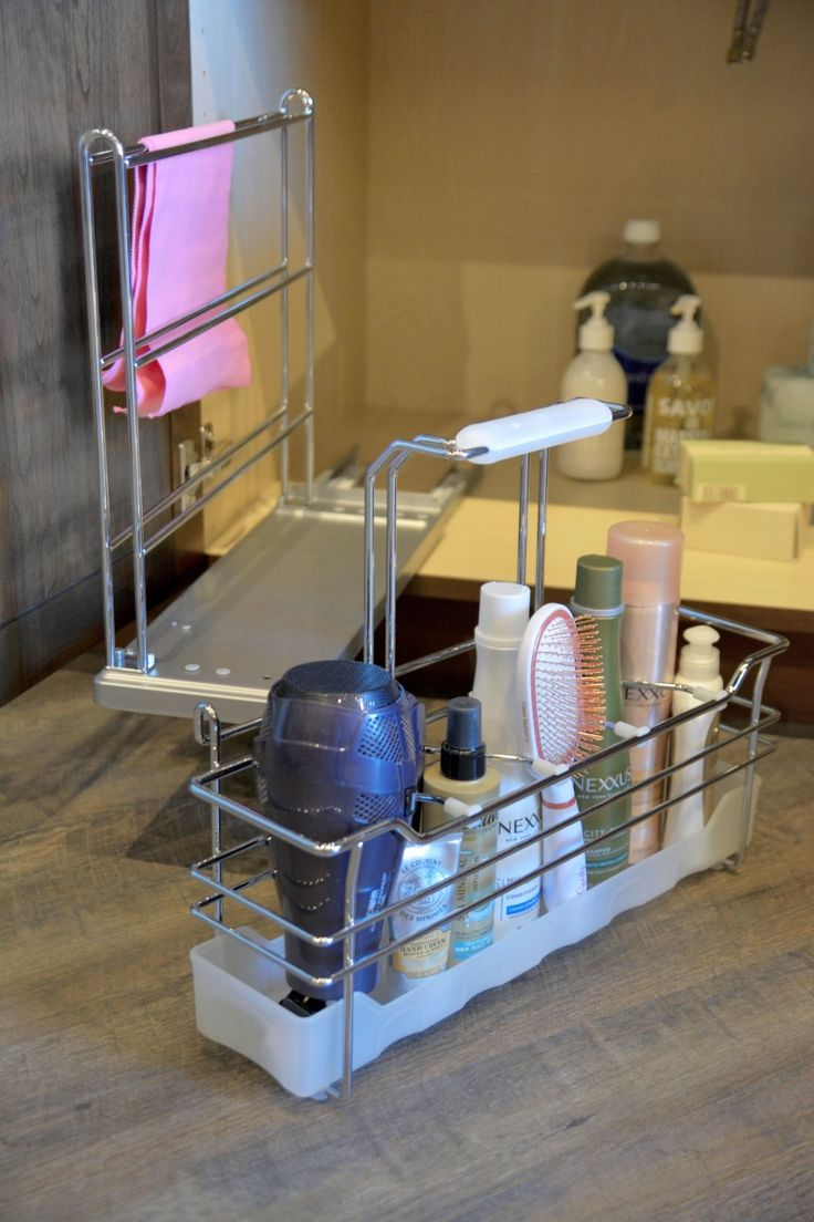 Solving Sink Storage in the Bathroom: Organize cleaning supplies or bathroom products with Dura Supreme's handy pull-out caddy with a detachable, portable basket.