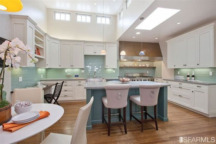 White cabinets, teal island, turquoise backsplash EXACTLY