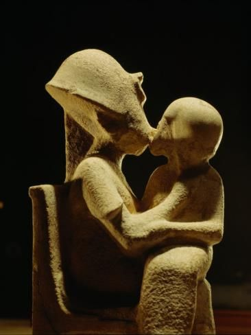 Statue of Akhenaten with child, Egyptian Museum in Cairo. (This depicts the 'breath of life', that was a gift, bestowed by Akhenaten, to the children of the chosen ones).