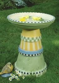 A birdbath made from terra cotta pots