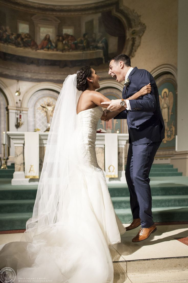 Newlyweds jumping for joy after the ring exchange at St. Paul's Cathedral in Toronto. Read their Luma Wedding Photographer Review.#sweetheartempirephotography