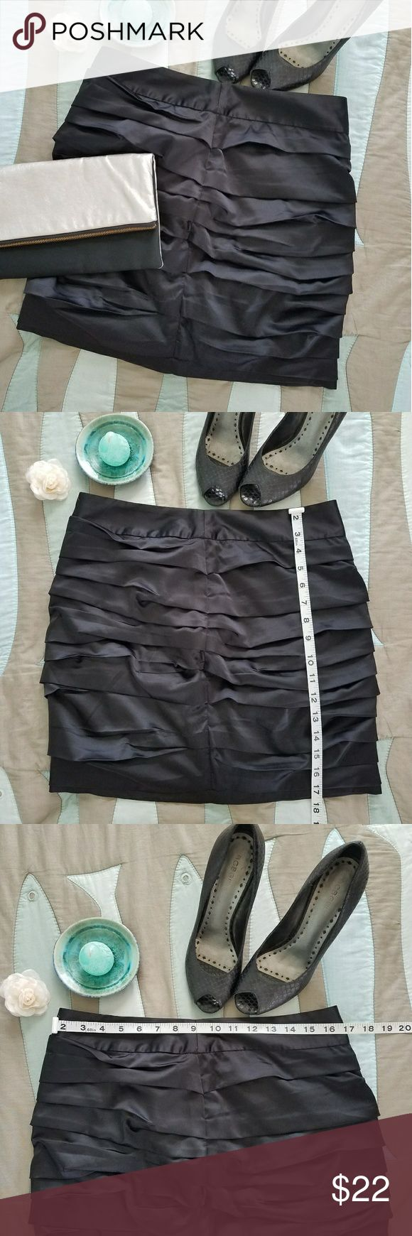 Express ruched black cocktail mini skirt Sexy ruched Express black mini skirt, polyester and spandex zip and hook back, noted as a size 8 but please see photo measurements. Pre-owned excellent condition. Express Skirts Mini