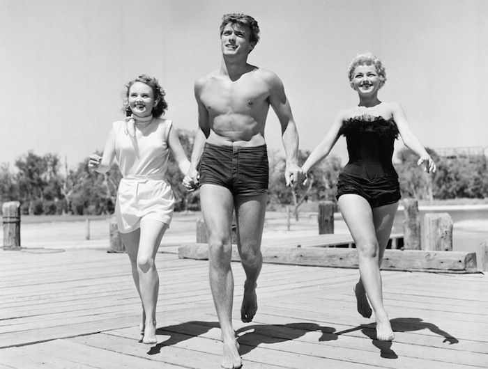 How Cool Was That! A beach-ready Clint Eastwood with actresses Olive Sturgess and Dani Crayne in San Francisco in 1954.