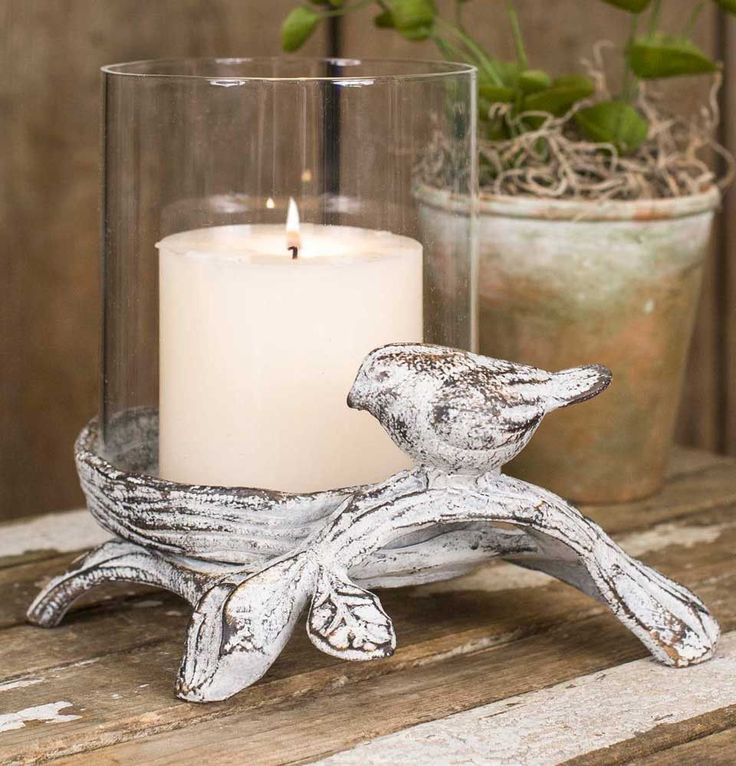 """7""""W x 5""""D x 6""""T. Includes a glass chimney. Shown with a 3"""" diameter candle, not included."""