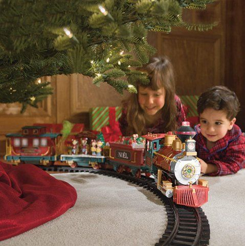 the family tradition of a lionel christmas train set either around the christmas tree or along side surrounding a fun christmas village - Train For Around Christmas Tree